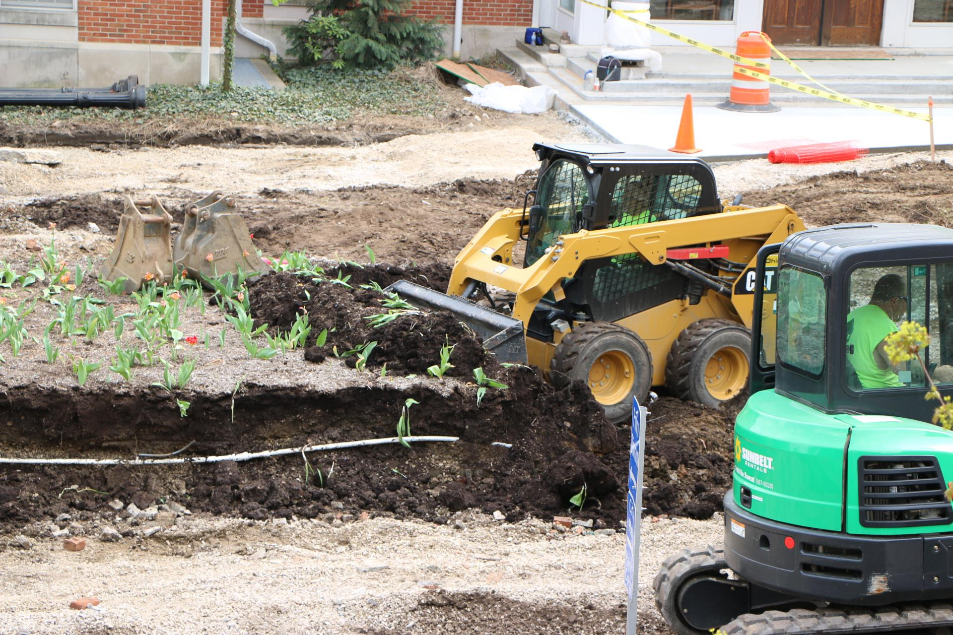 Crews demolish the large, brick planter.