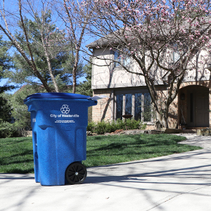 recycling cart in front of house new image